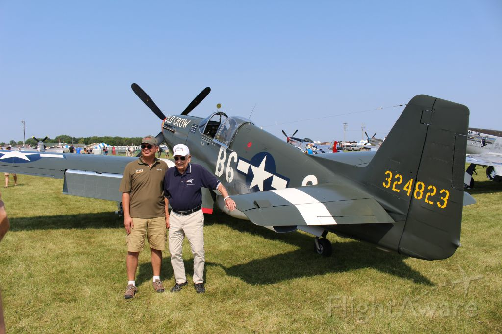 "— — - Living history- WWII Ace Clarence Emil ""Bud"" Anderson with Old Crow during EAA AirVenture 2019."