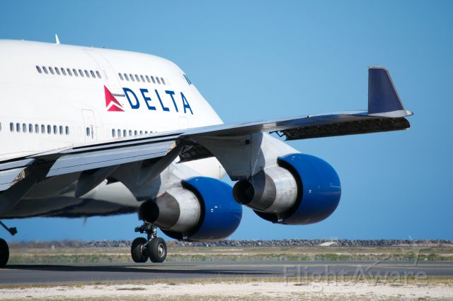 Boeing 747-400 — - Delta Boeing 747-400 showing off its wing at PHNL.