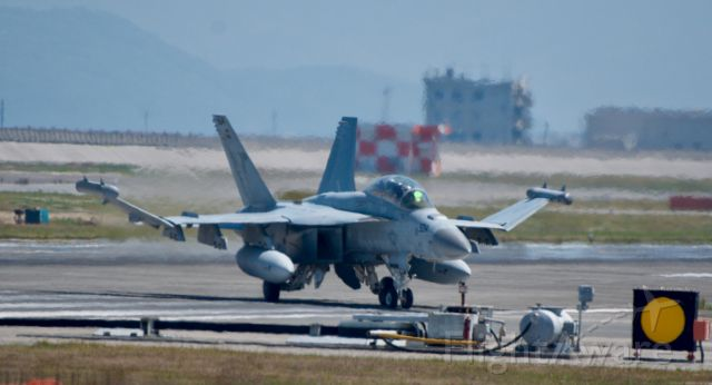 — — - This growler belong to VAQ-VAQ-141 (Shadowhawks) is taxing off the runway and onto bravo.