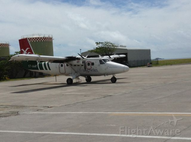 — — - Air Seychelles inter island service Twin Otter in her normal livery the green, red and white.  Sits at the International Airport on Mahe island at the domestic side of the field.