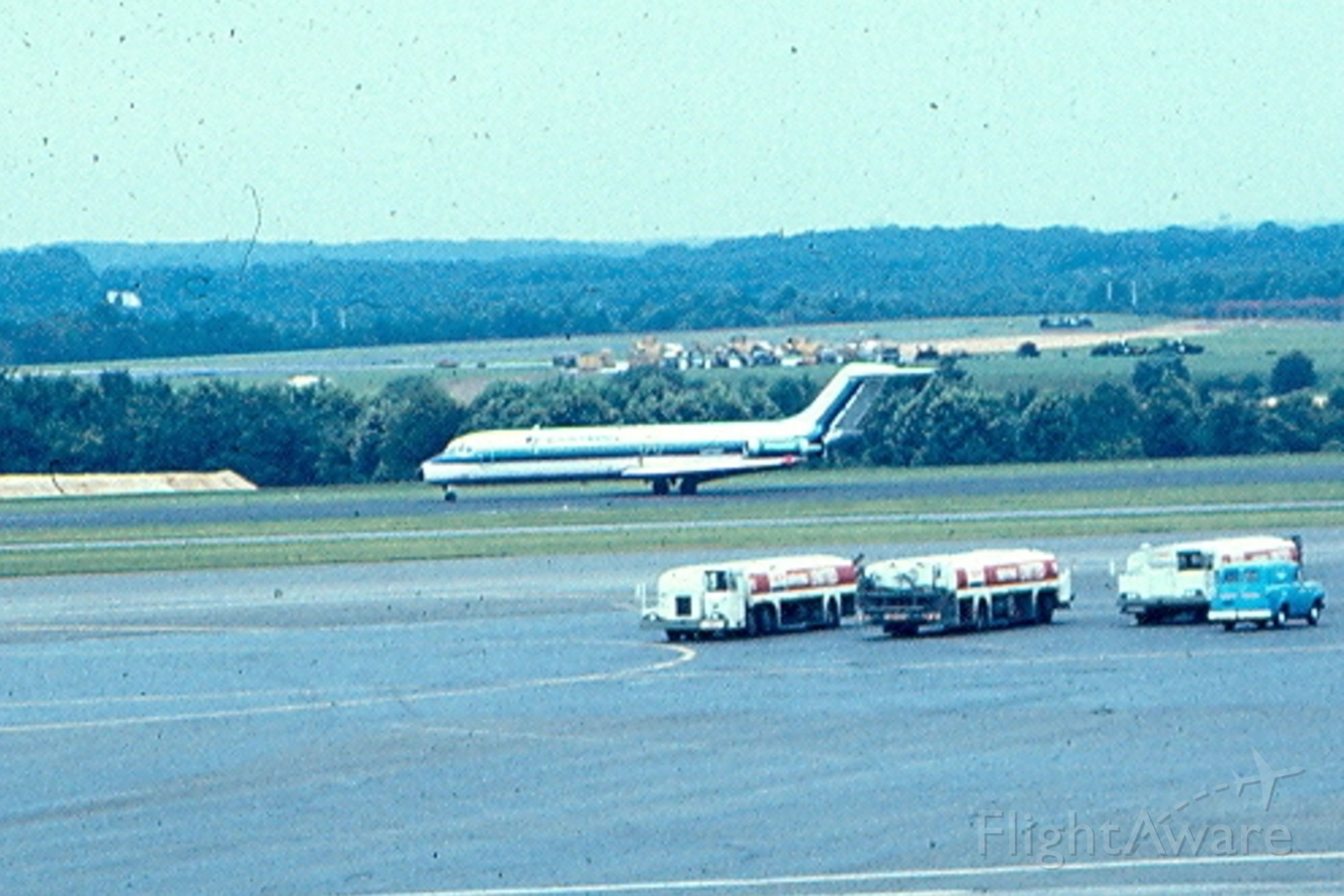 Douglas DC-9-10 — - Eastern Airlines DC-9 rolling out on runway 15 (now 15R) at Friendship Intenational Airport, Baltimore (now KBWI)  Note refuelers parked on field; Definatle not done now due to safty concerns.