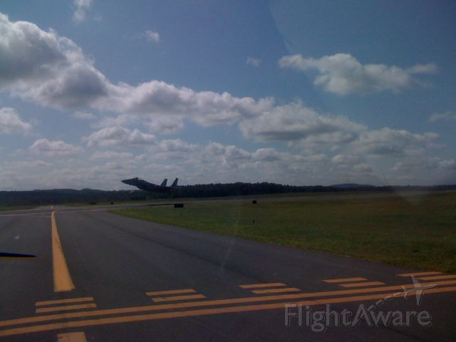 — — - F15C, 3rd in a flight of 3 taking off while I await an intersection departure - 8/5/08