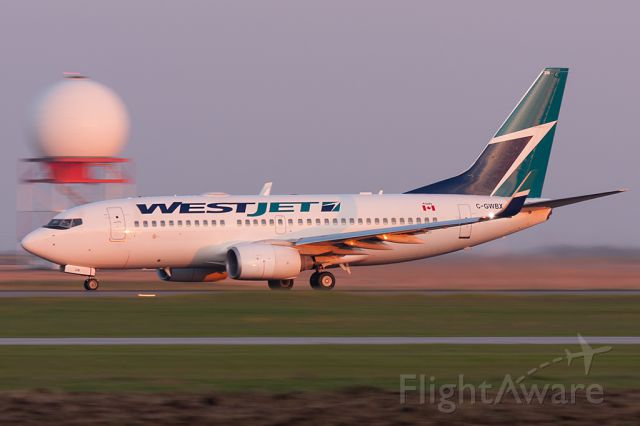 Boeing 737-700 (C-GWBX) - Taking Off Runway 18 In The Early Morning Light. [Canon 40D + 100-400mm]