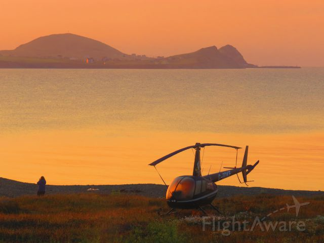 Robinson R-44 (C-GDKE) - Early morning on the beach. This little bird is used for scenic flights over the Magdalen Islands and is parked on the beach of our hotel for the night.