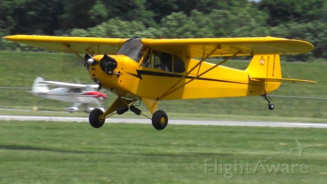 Piper NE Cub (N26838) - This Piper Cub was landing on runway 27L at the Sentimental Journey event held every year at Lock Haven Airport, PA. Long live the Cubs!