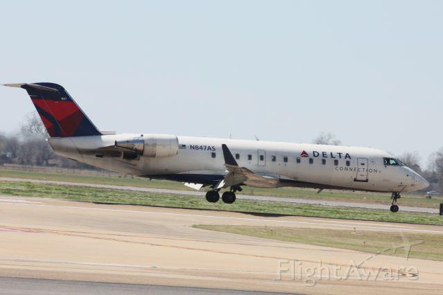 Canadair Regional Jet CRJ-200 (N847AS) - Landing on Runway 32.