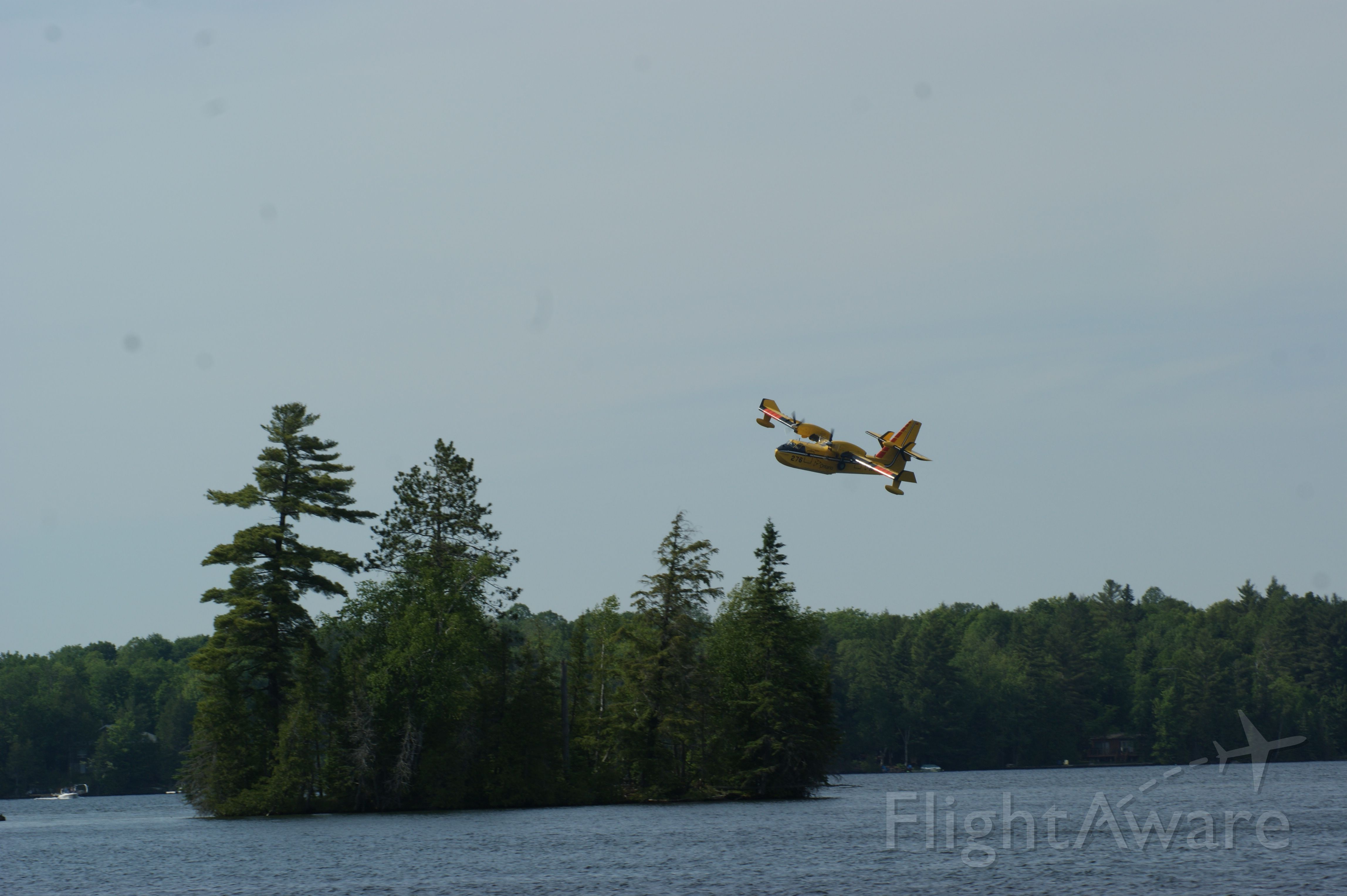 Canadair CL-41 Tutor (C-GOGX) - Crystal Lake, Ontario taken from our dock we had an awesome view as two SuperScoopers fought a nearby forest fire we could not see.