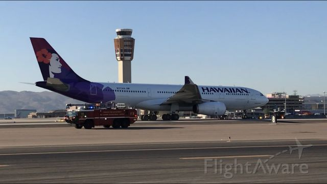 Airbus A330-200 (N373HA) - Emergency services standing by following a rejected takeoff for reported nose wheel shimmy from PHX. HAL35 11/7/2020