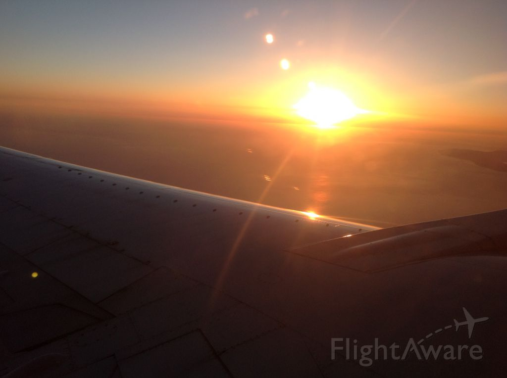 Boeing 737-700 — - Flying from SFO.  Sunset.
