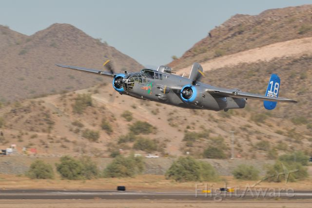 """North American TB-25 Mitchell (N125AZ) - B-25J """"Made In The Shade"""" making a low pass at Deer Valley Airport, AZ.  """"Made In The Shade"""" belongs to the AZ wing of the Commemorative Air Force.  Shot on 11/16/10."""