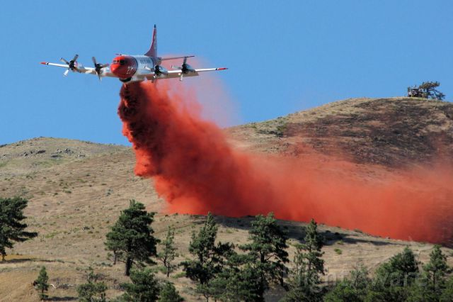 """Lockheed P-3 Orion (N923AU) - Aero Unions Tanker 23, a Lockheed P-3A, drops on the """"Brooklyn Fire"""" on the south side of Peavine Mountain around 4:30 PM on July 17, 2011."""