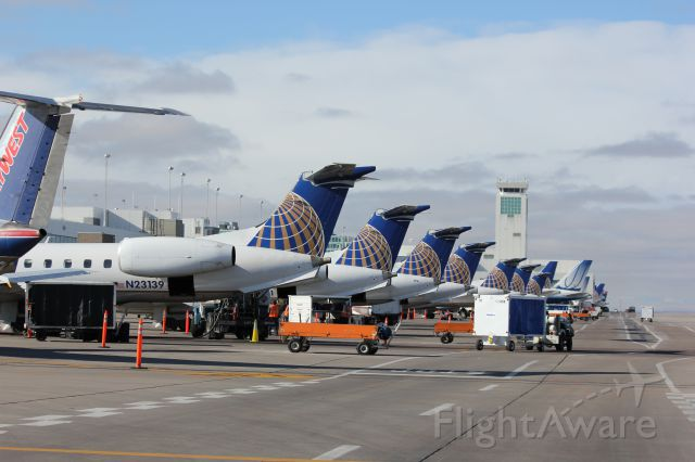 Embraer EMB-145XR (N23139) - Regional jets lined up at their gates on B concourse at DIA.