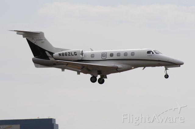 Embraer Phenom 300 (N862LG) - Landing at John Wayne Airport, July 18 2018.