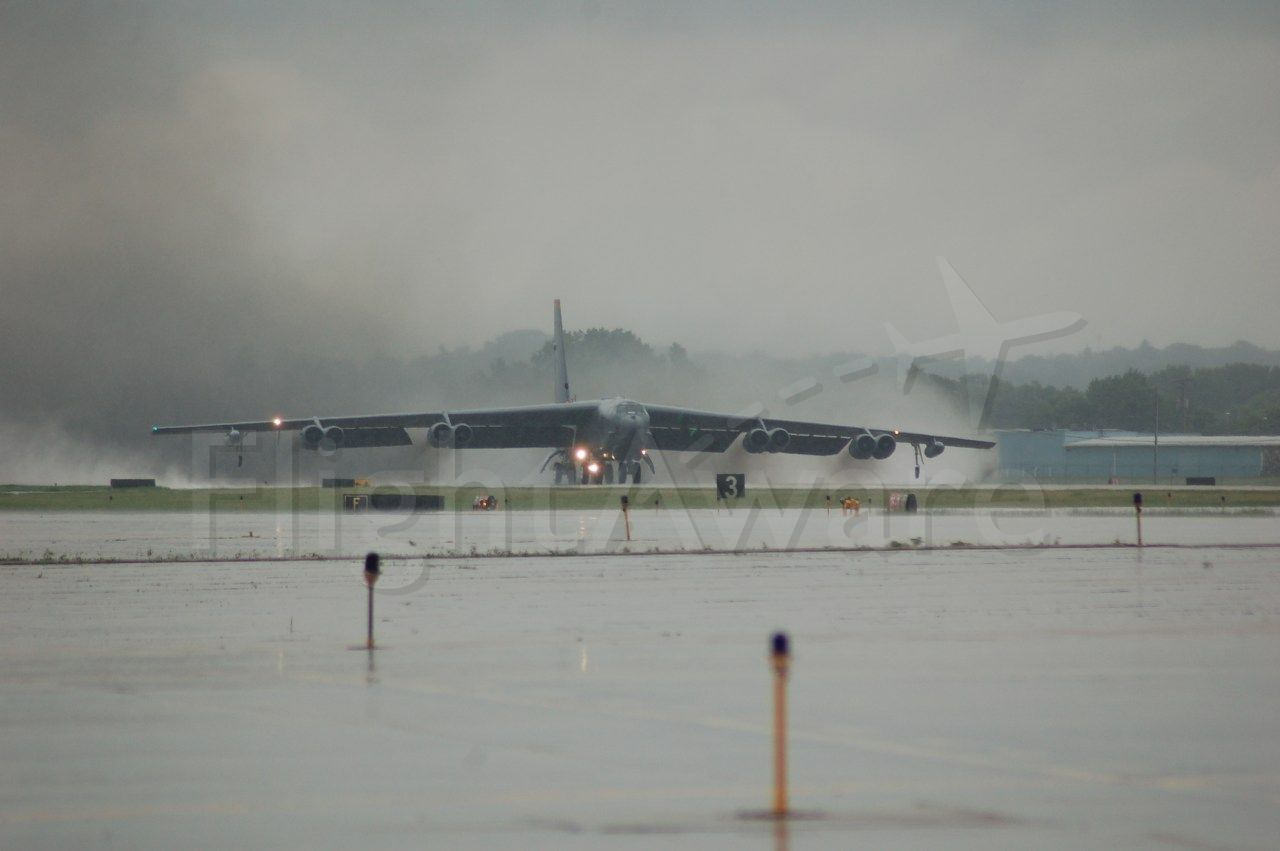 — — - USAF B-52H Blasts off with black smoke and water billowing out from RWY 25 KRFD. A/C is from Minot AFB, heading home