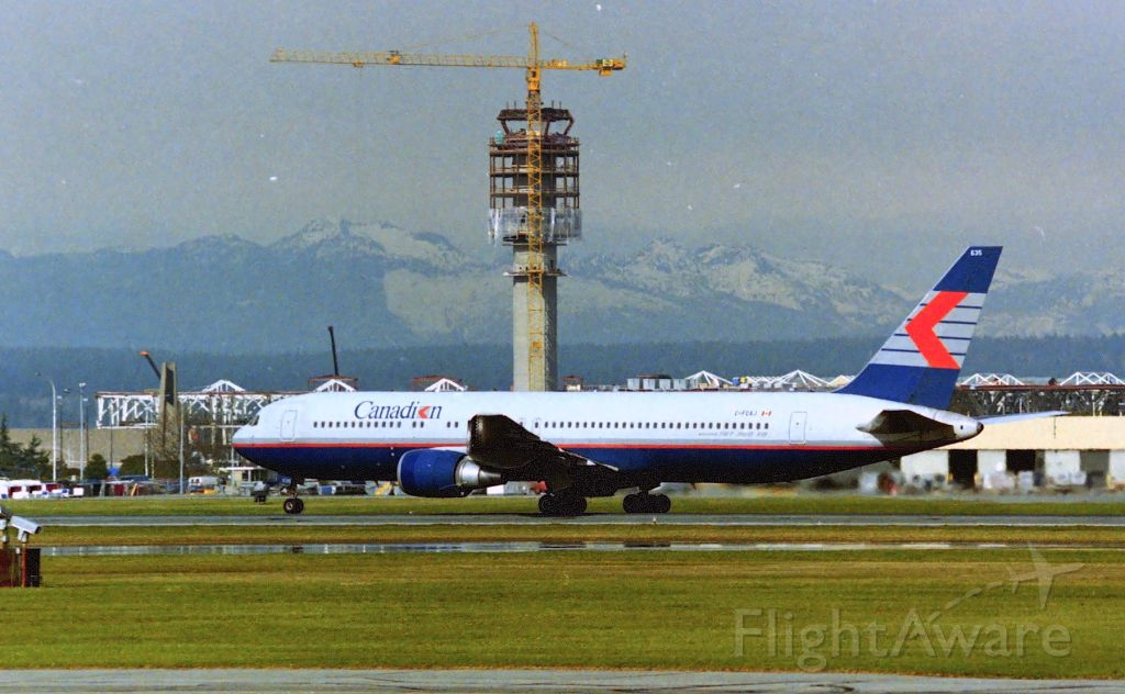 BOEING 767-300 (C-FCAJ) - CYVR - early 1990s photo from the old south terminal as a Canadien 767-300 departs with the new YVR Tower under construction in the background.