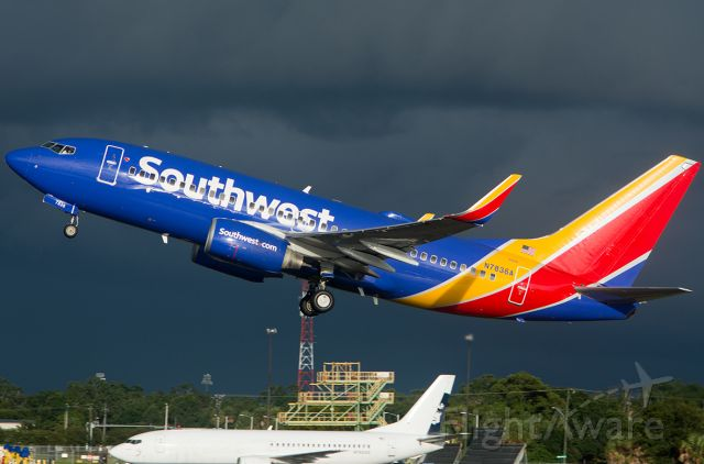 Boeing 737-700 (N7836A) - Departing after a Thunderstorm