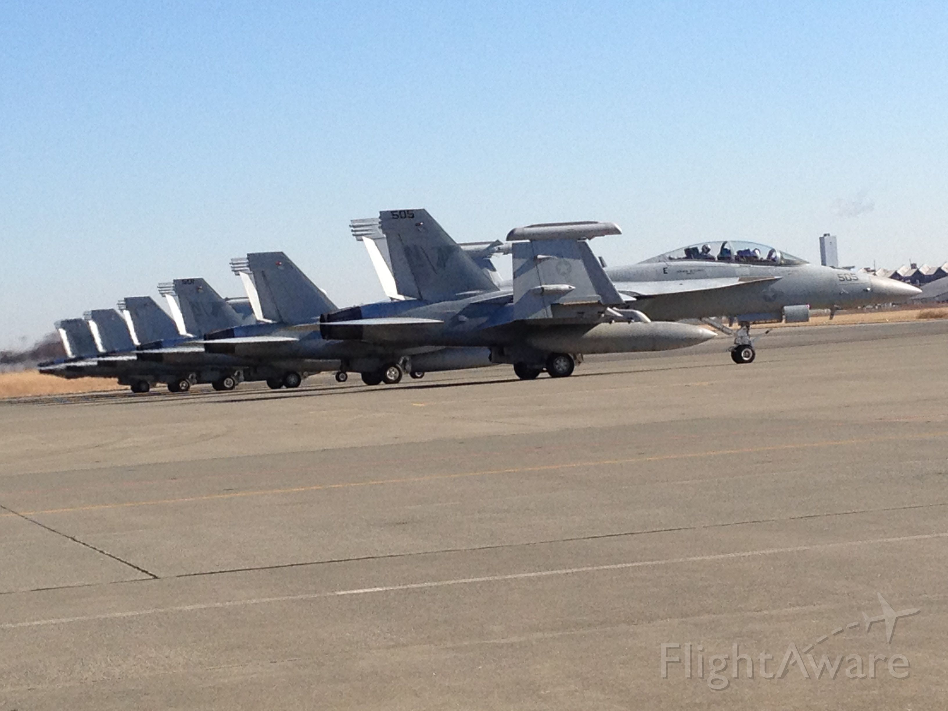 — — - F-18s with engines on waiting for everyone to ready up for takeoff in Atsugi Japan
