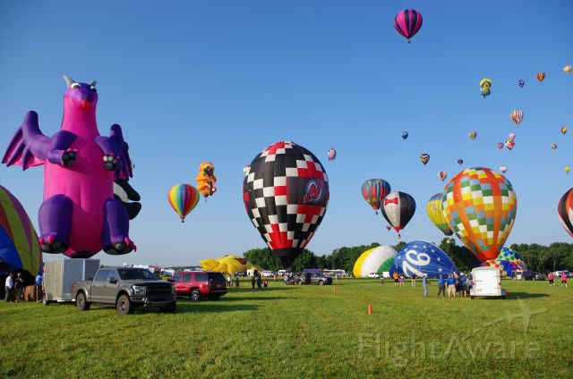 Unknown/Generic Balloon (N60TD) - SOLBERG AIRPORT-READINGTON, NEW JERSEY, USA-JULY 24, 2021: Seen at the 2021 New Jersey Lottery Festival of Ballooning were these colorful hot air balloons. The black-white-red NJ Devils balloon at the center is the one with registration number N60TD.