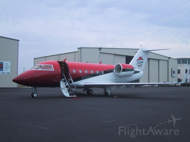 """— — - Pizza Hut corporate jet parked at """"Gate One"""" (now Atlantic Aviation)"""