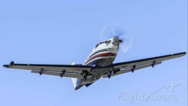 Pilatus PC-12 (N859PL) - Pilatus N859PL seen climbing out after takeoff from St Maarten.