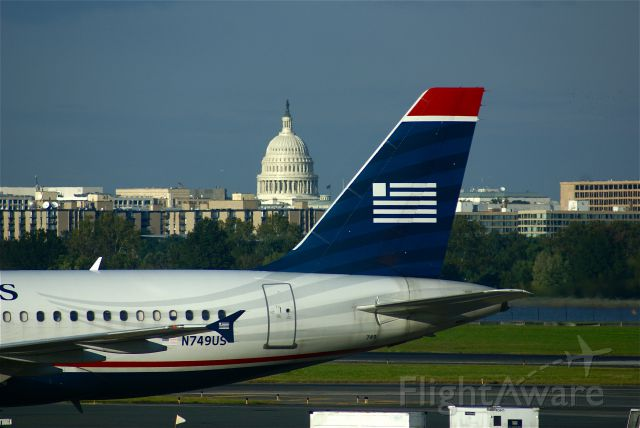 Airbus A319 (N749US) - U.S. Airways A319 parked with capitol in the background.