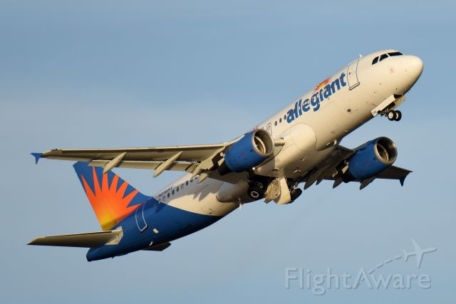 Airbus A320 (N216NV) - Departure in late afternoon. Positive rate, gear up.