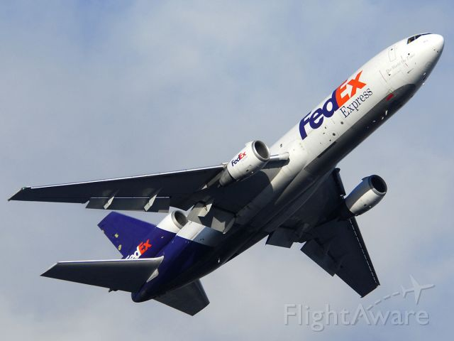 McDonnell Douglas DC-10 (N308FE) - FedEx MD-10-30F departing from Runway 7 Right with a load of Christmas cargo.
