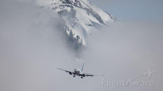 Boeing 737-700 (N615AS) - Alaska flight 64 on approach to Juneau