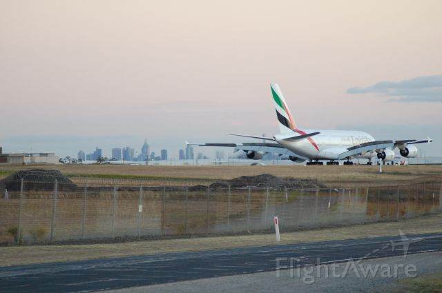 Airbus A380-800 (UNKNOWN) - Was distracted by something else and looked up to see this big bird taxiing in. Melbourne City in the background.