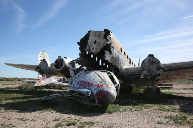 Douglas DC-7 (N44904) - These are the remains of one of the many DC-7's sitting abandoned at the Gila Memorial Airport in South Mesa, Arizona.