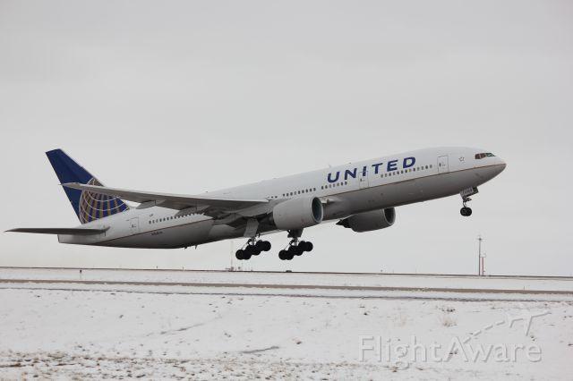 Boeing 777-200 (N768UA) - Taking off on 17R.
