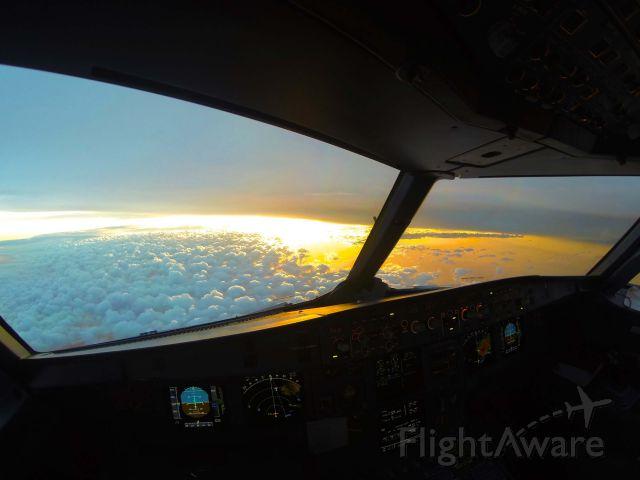 "Airbus A320 — - A ""molten sunset"" descending into KDFW"