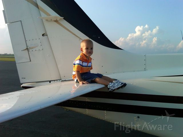 Beechcraft 55 Baron (N1832W) - Cason Allen Plaugher, grandson of David Moore and son of Jenny and Chad Plaugher. He wonders if I can really stay on this tail during takeoff?