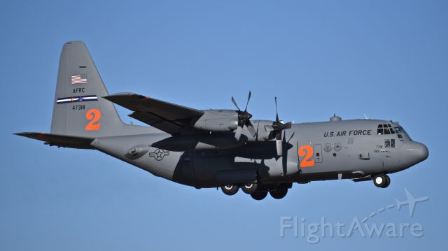 """Lockheed C-130 Hercules (94-7318) - USAF Lockheed C-130H """"Hercules,"""" assigned to the 302nd Airlift Wing, on final for RWY 17L at Colorado Springs Airport. This Hercules is with the subordinate 731st Airlift Squadron (US Air Force Reserve) and capable of both tactical airlift missions as well as aerial fire fighting operations."""