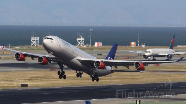 Airbus A340-300 (LN-RKG) - SAS A340-300 fighting the crosswinds on departure from SFO