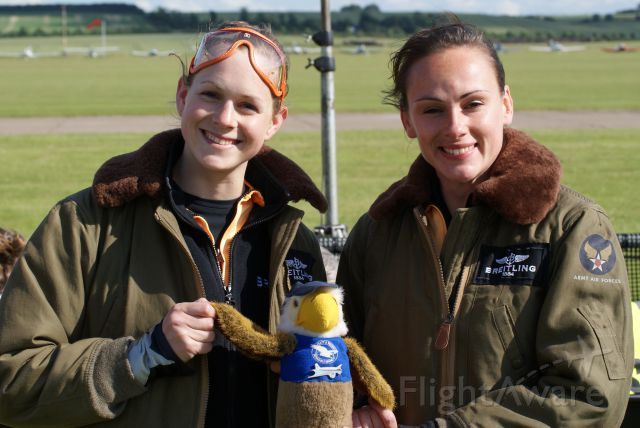 "— — - The Brietling Wingwalker ladies with ""Douglas"" the FlyDC3 NZ mascot @ Flying Legends airshow,Duxford 01 July 12"