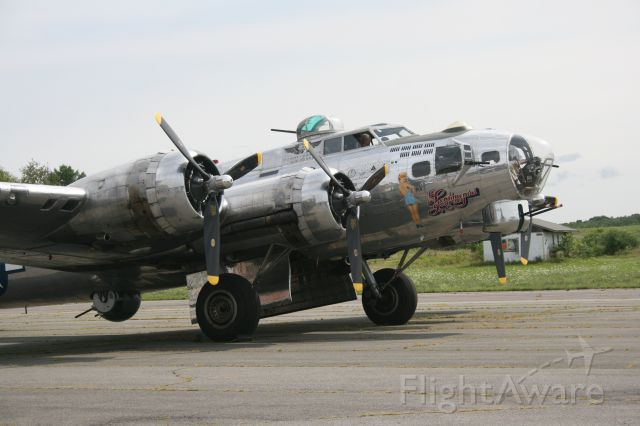 — — - On the tarmac at Schenectady County Airport on August 16, 2014 with Sentimental Journey, B17G, of the Commemorative Air Force