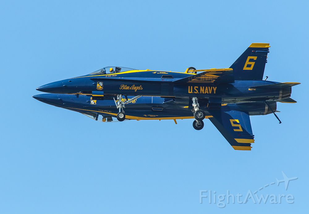 McDonnell Douglas FA-18 Hornet — - Blue Angels 5 & 6 with gear down performing a side by side pass. Notice that pilot #5 is looking ahead and #6 is only watching aircraft separation. What great performers!