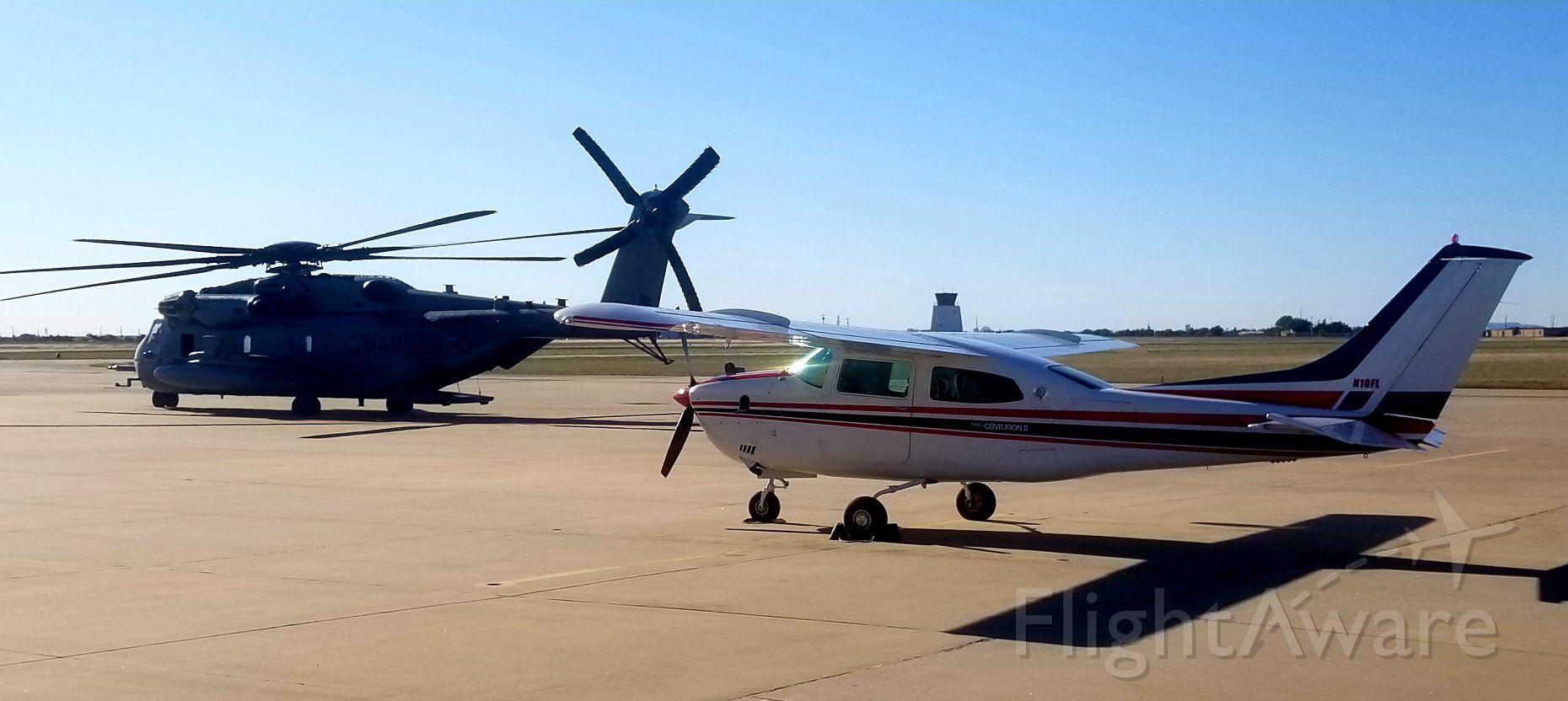 Cessna T210 Turbo Centurion (N10FL) - Chopper refueling and Cessna visiting