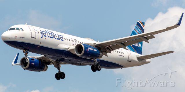 "Airbus A320 (N804JB) - JetBlue Airways Airbus 320-232 nicknamed ""Got Blue"" arriving from Santiago, Dominican Republic landing on runway 29 at Newark on 7/28/21."