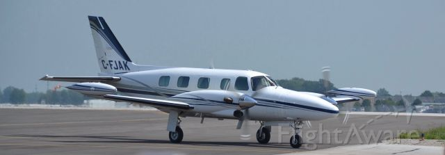 """Piper Cheyenne 2 (C-FJAK) - A """"Piper Cheyenne 2"""" taxing at """"Windsor International Airport""""."""