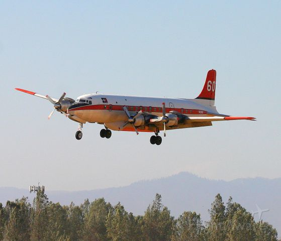 Douglas DC-7 (N838D) - KRDD - DC-7B Erickson Aero Tanker N838D, Sept 2014 returning from Weed,CA for more PhosCheck before turning back north to help fight the Boles Fire in Weed.