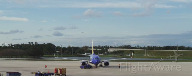 Boeing 737-700 (N933WN) - Southwest 3723 being pushed back for takeoff from MCO to MSY
