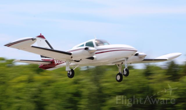 Cessna 310 (N4258C) - Taking off runway 8 at MCD enroute to LDM. Notice the wave from the pilot