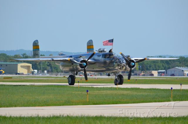 North American TB-25 Mitchell (N27493) - Deke Slayton Airfest June 2014. B-25 Miss Mitchell taxiing with flag displayed.
