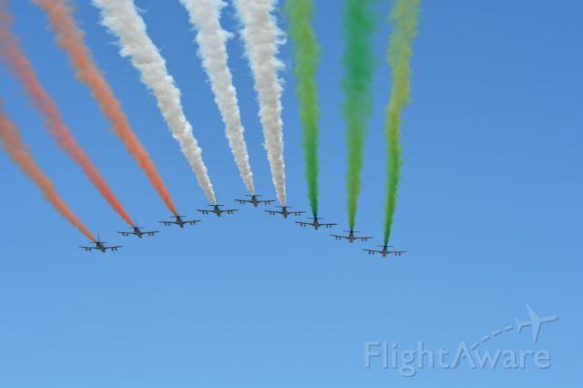 """— — - Italian Air Force display team the """"Tricolour Arrows"""" just prior to the start of the Italian Grand Prix on 6 Sep 2015"""
