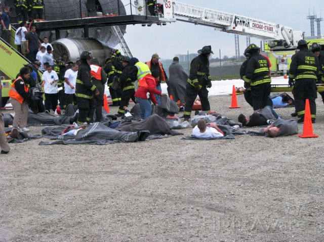 — — - ORD Mass disaster drill. Very realistic drill held on a Saturday morning. The casualties are volunteers from Great Lakes Naval Base. All Part 139 airports are required to have such a drill every three years.