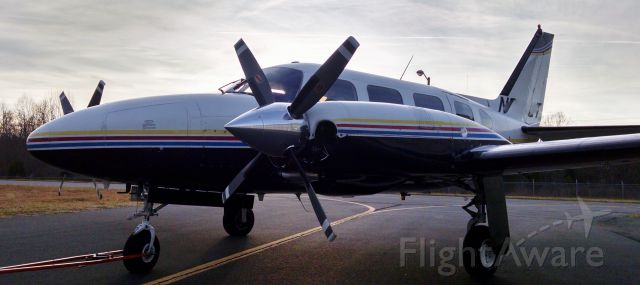Piper Navajo (N853CT) - Sitting on ramp at KEXX on a winter morning