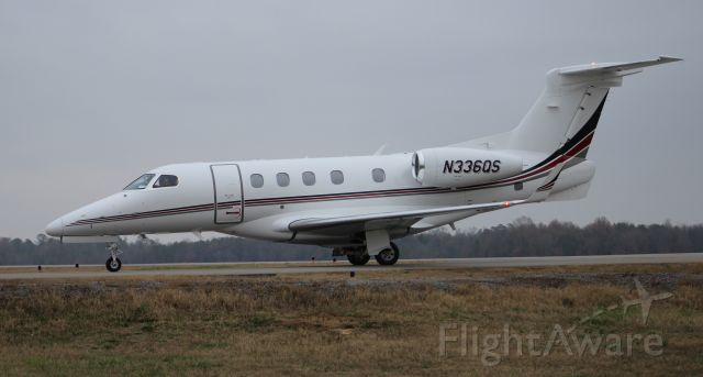 Embraer Phenom 300 (N366QS) - An Embraer EMB-505 (according to the online FAA Registry) Phenom moving up the taxiway under overcast skies after landing at Pryor Field Regional Airport, Decatur, AL - December 20, 2016.