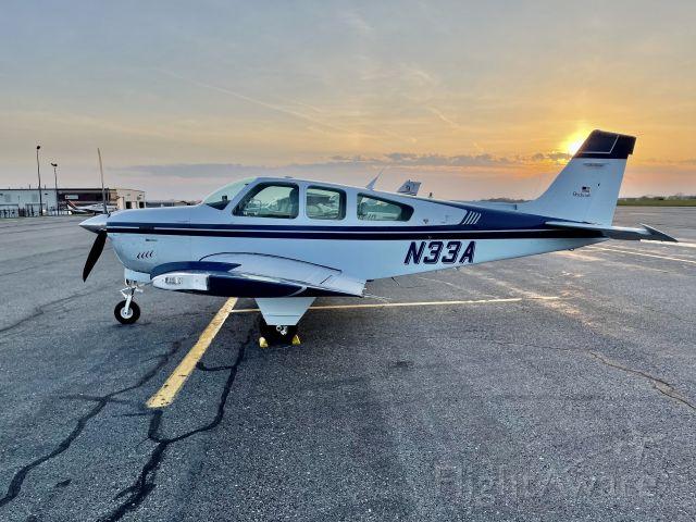 Beechcraft Bonanza (33) (N33A) - Parked at sunset.